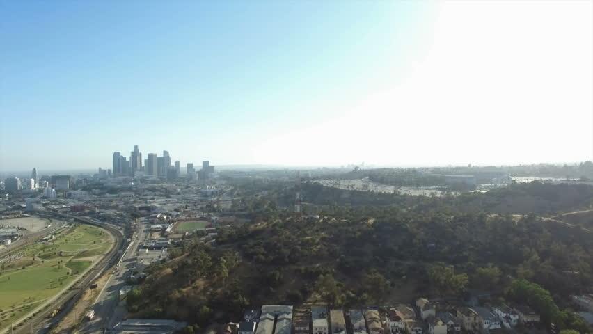 Aerial pedestal down of Los Angeles view behind Radio Hill