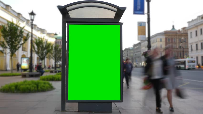 Time Lapse. A Billboard with a Green Screen on a Busy Street