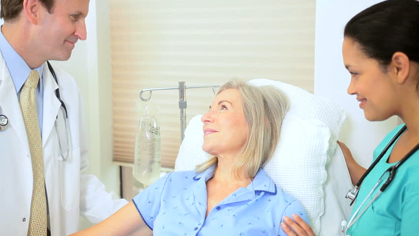 Hospital consultant nurse giving medical care to senior retired female patient   Shutterstock HD Video #2869987