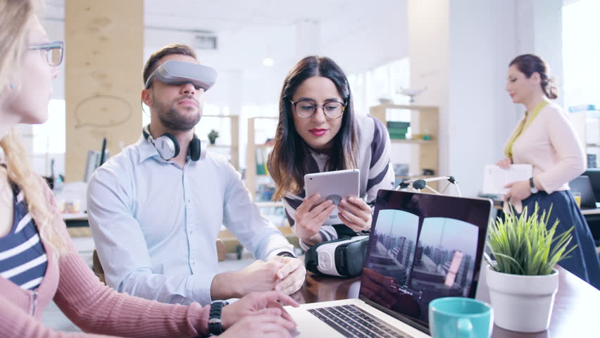 Trendy Designers Wearing Virtual Reality Vr Headset Glasses Teamwork Startup Innovation Testing Augmented Reality Headset Programming AR Vr Application Creating Virtual Reality Applications Innovative #28700131