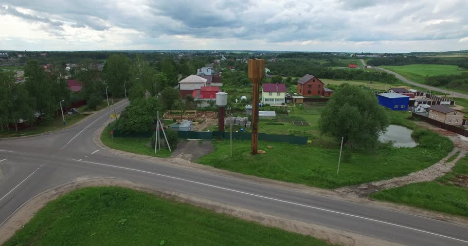 4K aerial video footage view of old abandoned metal water tower, road and area around it in Volokolamsk near Moscow, capital of Russia in cloudy summer afternoon | Shutterstock HD Video #28701520
