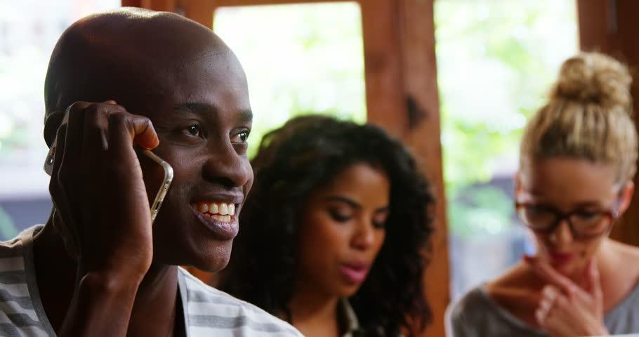 Happy man talking on mobile phone in café   Shutterstock HD Video #28704277
