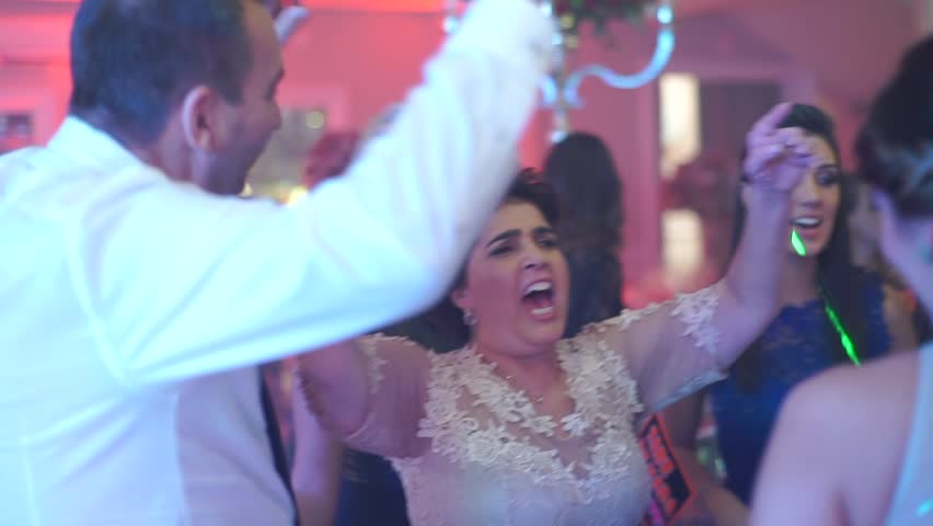 Family dancing at the wedding dance floor