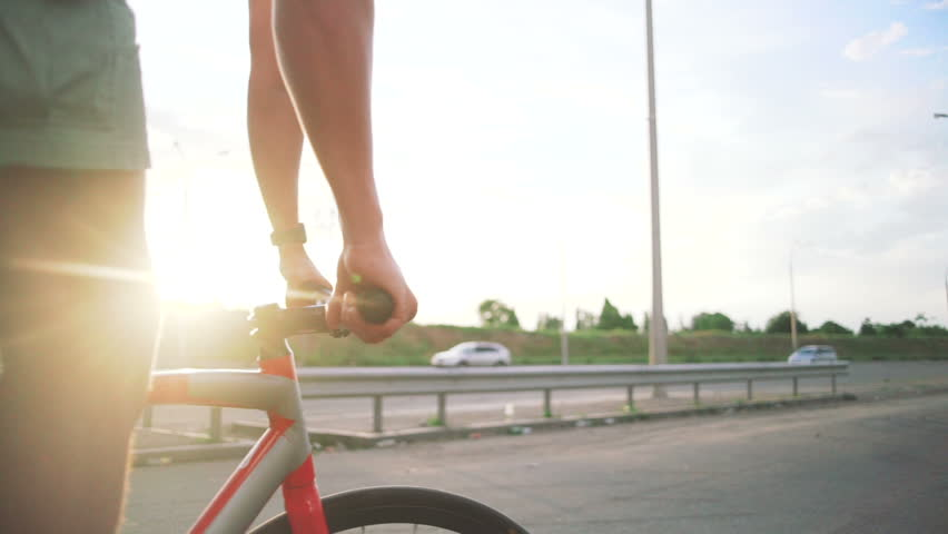 Young handsome hipster man riding fixed gear bicycle during sunset, outdoor #28716925