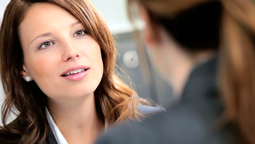 Female banking executive greeting young businesswoman to discuss future financial plans | Shutterstock HD Video #2872159