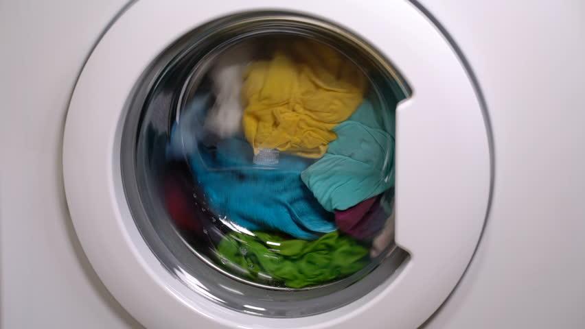 Washing machine is washing clothes