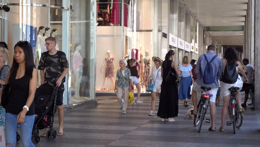 MILAN, ITALY - JUNE 18, 2017: Pedestrian walk through Shopping Gallery with many Stores Showcase with Mannequin of Milan Italy | Shutterstock HD Video #28727773