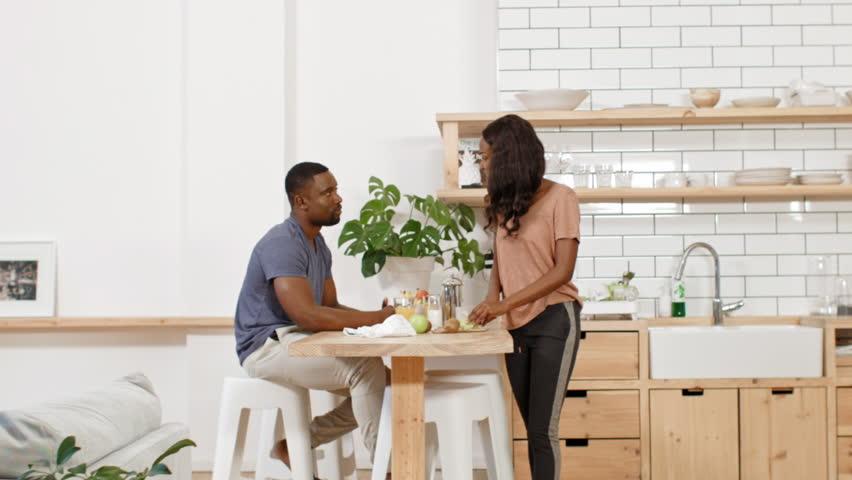 Loving couple eating breakfast in kitchen, woman feeding husband #28728238