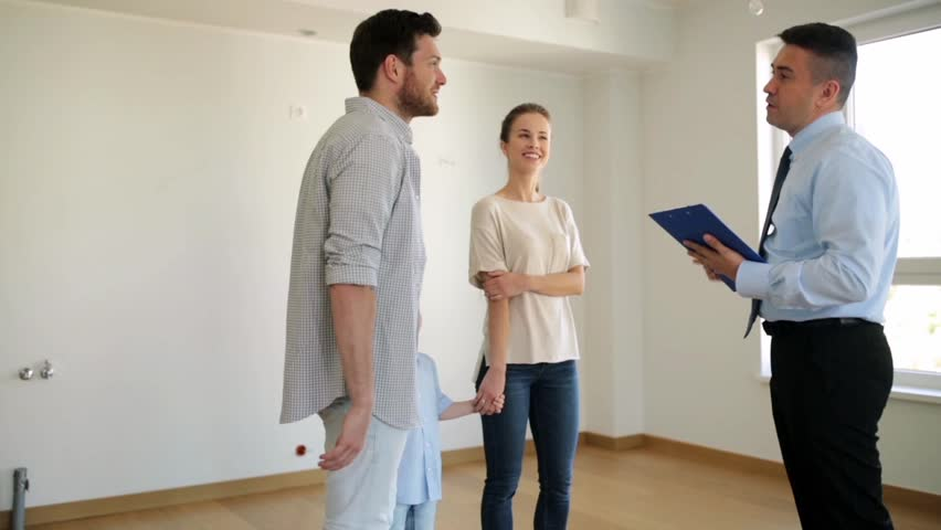 Mortgage, housing and real estate concept - happy family and realtor with clipboard showing new house or apartment
