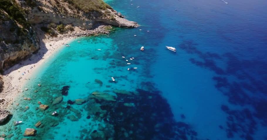 Aerial view of a beautiful beach with clear blue water. Gulf of Orosei, Sardinia.
