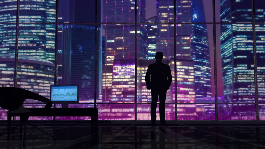 Businessman in an office on a background of night skyscrapers #28753732
