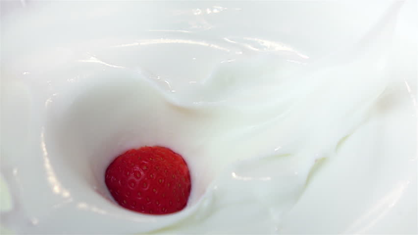 High quality video of strawberries falling into yogurt in real 1080p slow motion 250fps