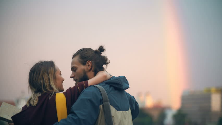 Romantic date of young couple in the city centre on sunset. Happy man and woman hug, kiss, enjoying the time together. #28762081