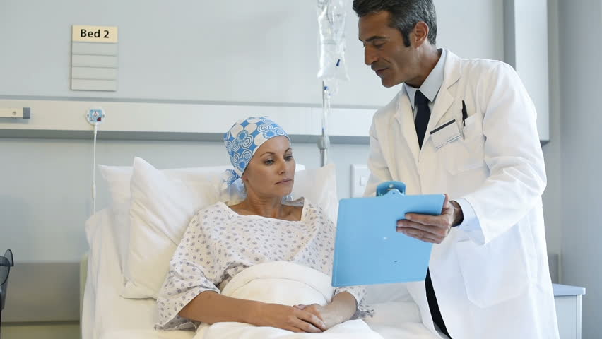 Doctor telling to patient woman the results of her medical tests. Doctor showing medical records to cancer patient in hospital ward. Senior doctor explain the side effects of the intervention.