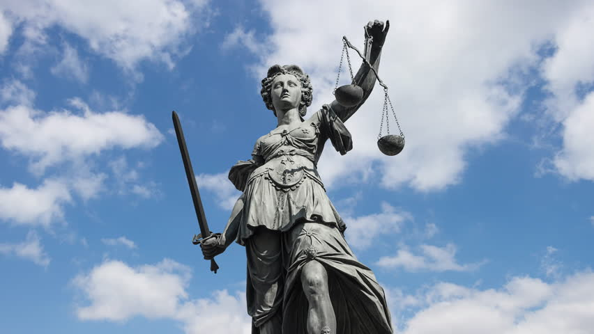 Lady justice goddess of Justice zooming in in front of moving clouds, 4k | Shutterstock HD Video #28776604