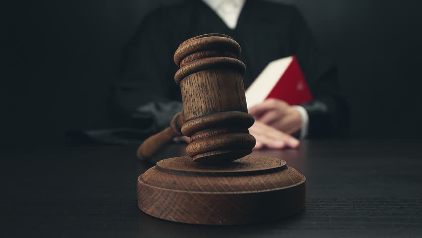 Judge with law book pounding gavel in slow motion | Shutterstock HD Video #28776640