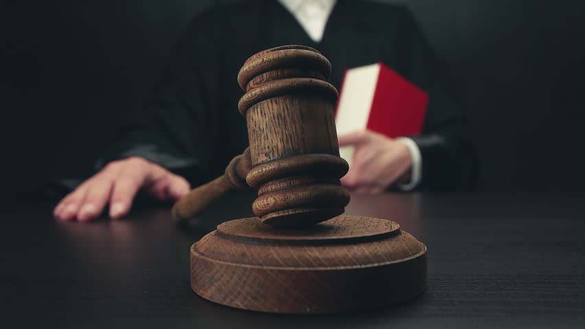 Judge hammering with a gavel on a block in slow motion | Shutterstock HD Video #28776655