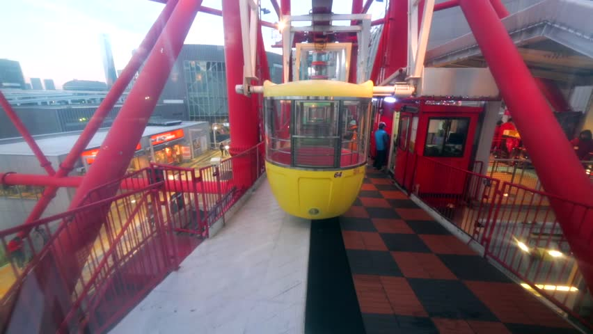 TOKYO, JAPAN - DECEMBER 14, 2016: View of moving cabin from another glass cabin at Daikanransha, a 115-metre (377 ft) tall Ferris wheel at Palette Town in Odaiba | Shutterstock HD Video #28798990