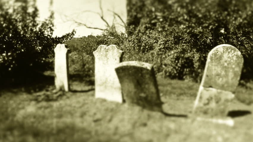 Retro Graveyard 1. Headstones in an old graveyard. HD shot edited in post for a classic film / retro look.