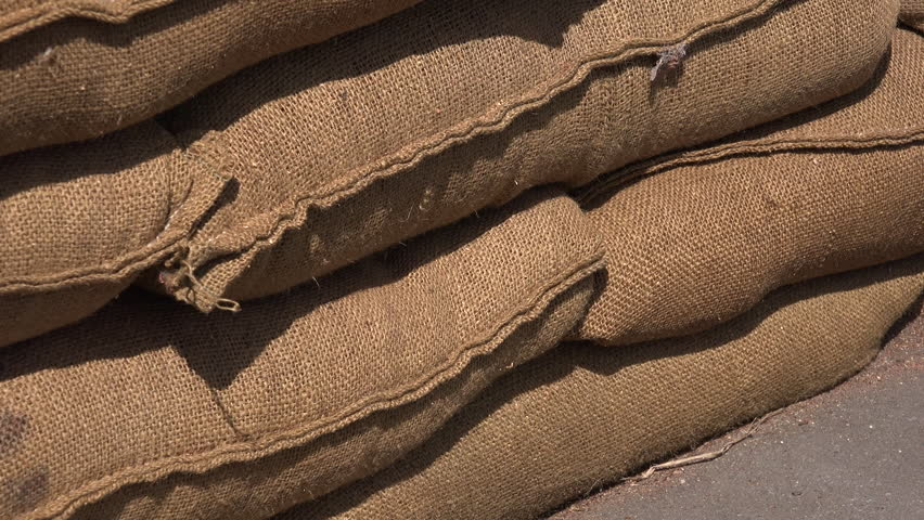 Background of sand bags moving shot 4K