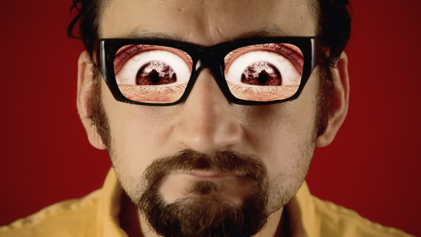 A funny ugly man with hypnotic glasses, showing big painful eyes. Weirdness, surreal, dream.