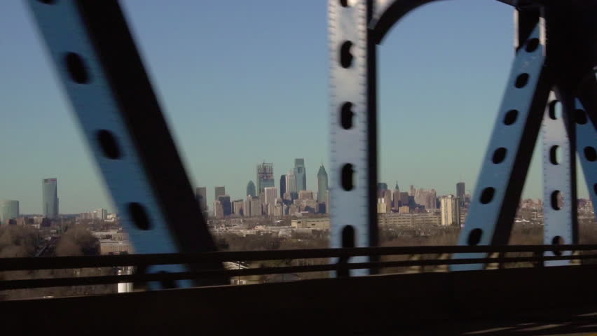 View of the Philadelphia Skyline while driving over the Betsy Ross Bridge, in slow motion