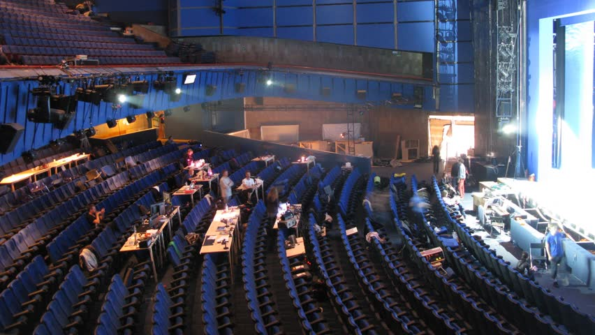 Actors go in spectator hall and on theater scene during rehearsal, time lapse #2885782