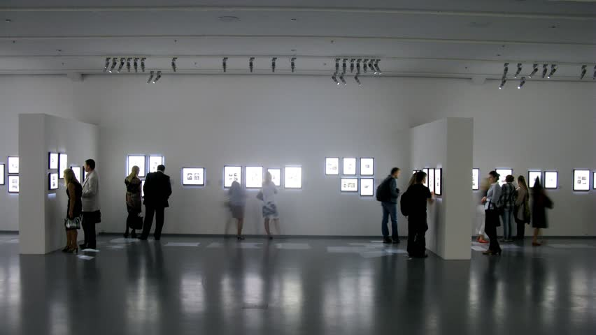 MOSCOW - AUG 16: (Timelapse View) People walk at exhibition in Moscow house of photo, on Aug 16, 2012 in Moscow, Russia