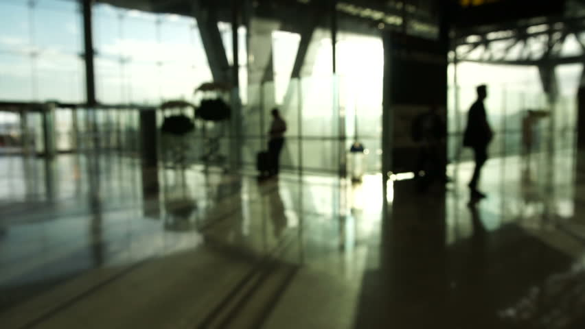 Blur crowd of people silhouette walking in airport with glass structure and sunrise background. Abstract business and traveler | Shutterstock HD Video #28859710