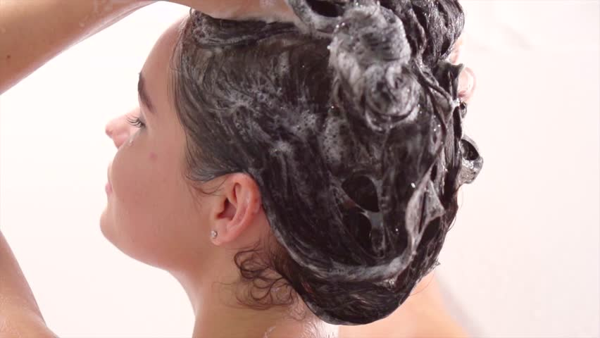 Beauty young woman washing her hair with shampoo. Beautiful brunette model girl takes shower, washing hair in a bath. Hair care, beauty and wellbeing concept. Slow motion 240 fps. 4K UHD video. #28872265