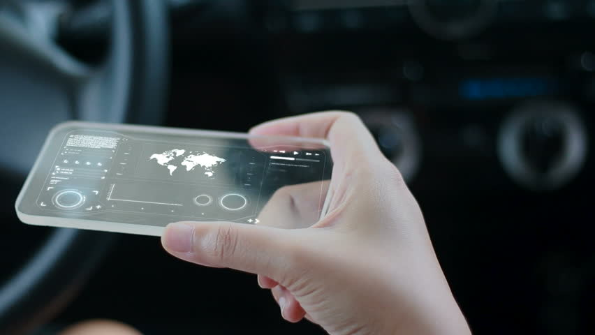 Close up shot hands of woman using clear glass smart phone in the car for futuristic cyber technology concept | Shutterstock HD Video #28892098