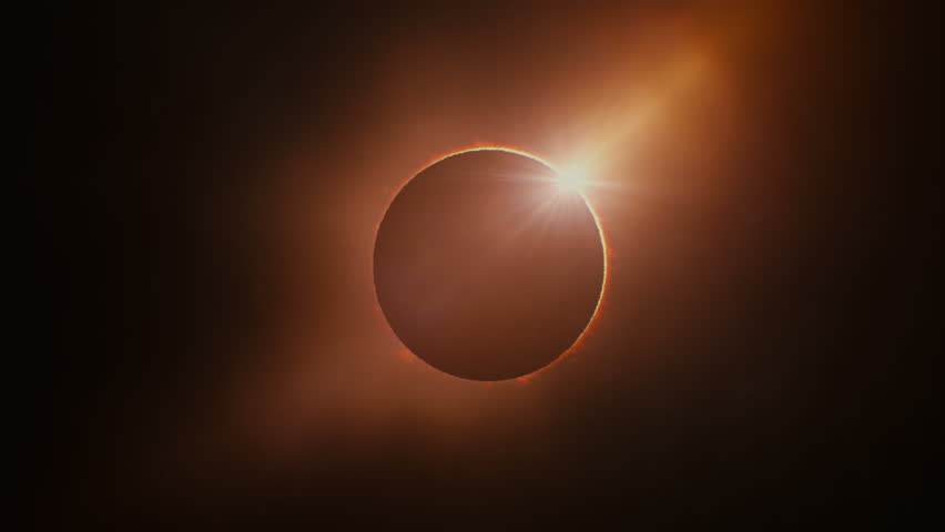 Full solar eclipse. The Moon mostly covers the visible Sun creating a ring of fire. This astronomical phenomenon can be seen as a sign of the End of the World. Royalty-Free Stock Footage #28907302