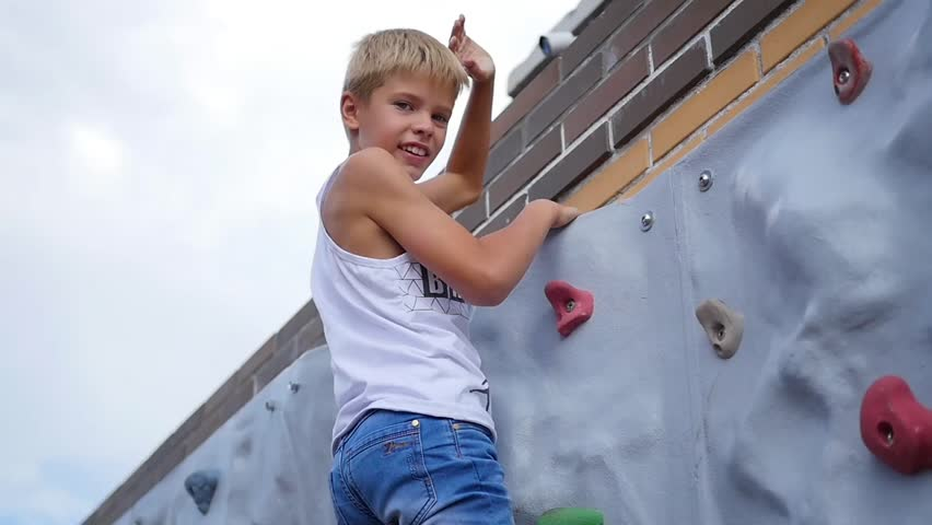 the teenager down the wall for climbing. sports outdoors