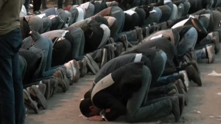 CAIRO, EGYPT – CIRCA DEC 2011: Muslim are praying in Tahrir Square during the clashes