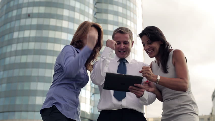 Business success - happy executives with tablet computer