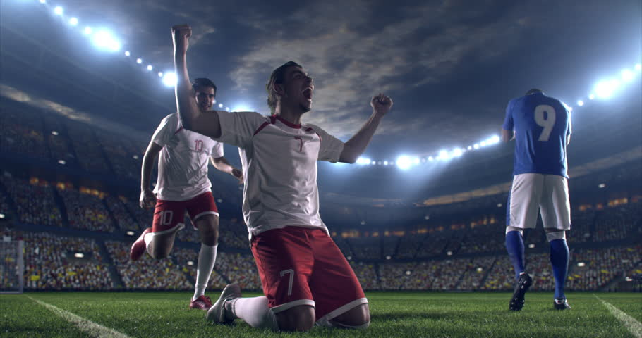 Professional footballer is happy and slides with his hands to the air. Another soccer player runs after him happily. Action takes place on soccer stadium.  Stadium and crowd are made in 3D.