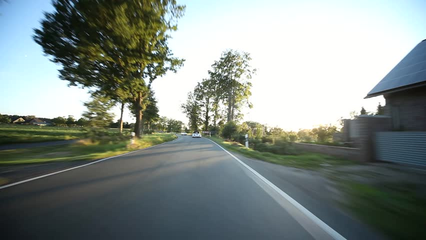 Video footage of a on-board camera on a car driving on a country road in the sunset | Shutterstock HD Video #2895757