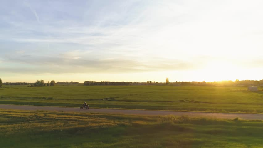 Riding vintage custom made cafe racer on a sunset | Shutterstock HD Video #28978861