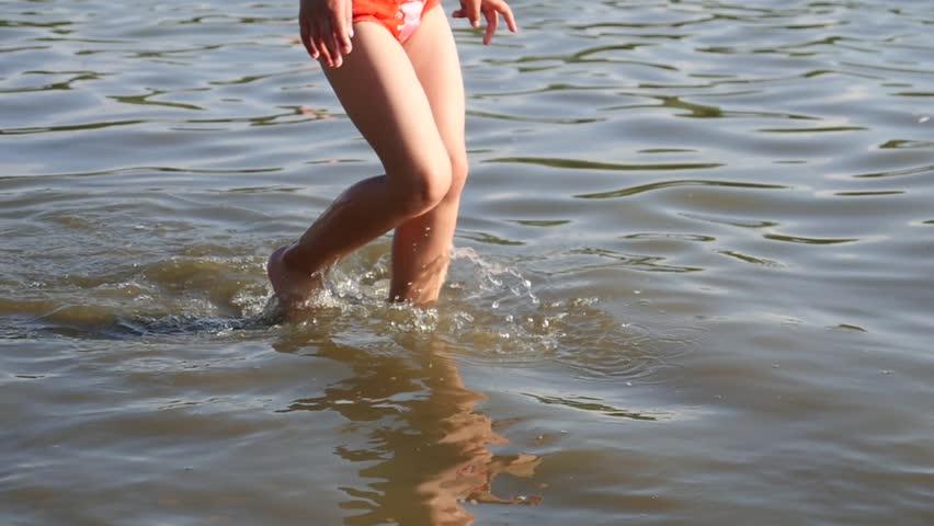 Lake Beach Rest Little Kid Girl Legs Running In Shallow Water Near Shore In Slow Motion | Shutterstock HD Video #28981267