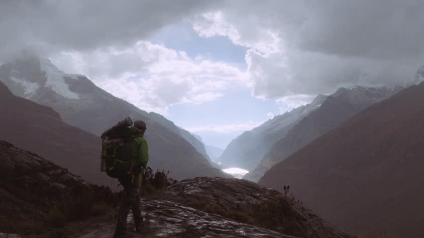 Silhouette of a backpacker walking on the peak of a mountain, Santa cruz Trek, Peru. 4k