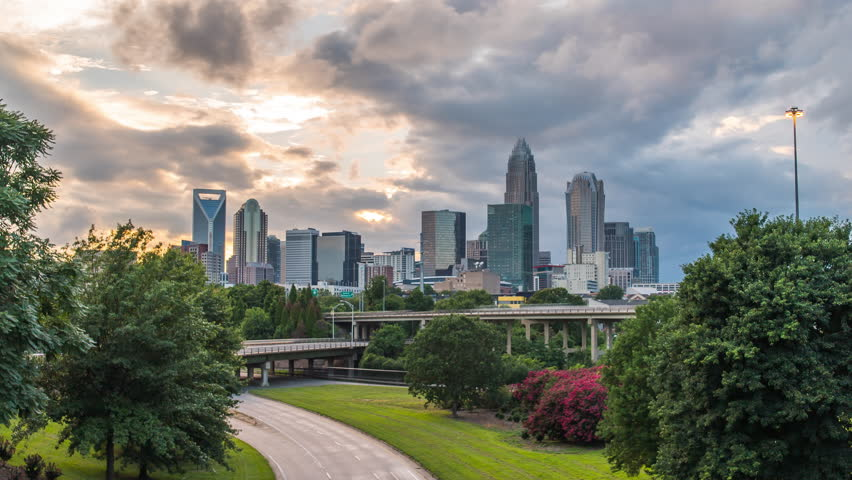 Charlotte sunset time lapse over bridge 4k 1080p - Sun setting behind charlotte north carolina skyline from bridge