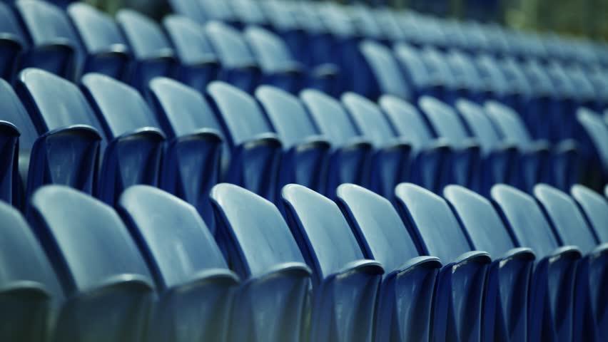 Panning close up of empty stadium seats | Shutterstock HD Video #28990195