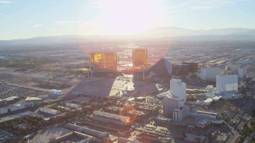 Las Vegas USA - April 2017: Aerial sun flare landscape city view at sunset of luxury Hotels and Casinos Nevada RED EPIC | Shutterstock HD Video #29009464