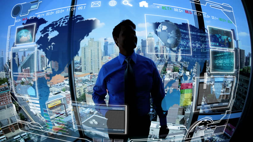 Young male Caucasian businessman in silhouette using financial investment business communications touchscreen motion graphics technology