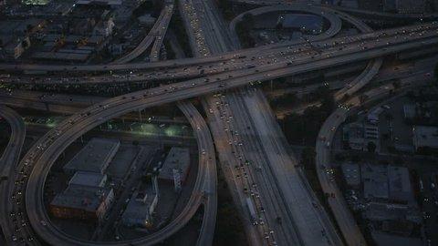 Los Angeles USA - April 2017: Aerial vertical illuminated view of traffic freeway intersections in congested commuter cities California RED EPIC
