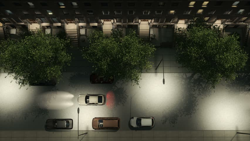 Straight overhead aerial view of night city street lit by streetlights with brownstone apartment buildings, parked and moving cars. Realistic 3D animation rendered in 4K