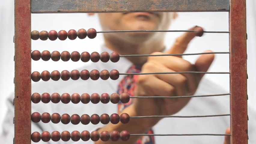 out of focus man and old abacus
