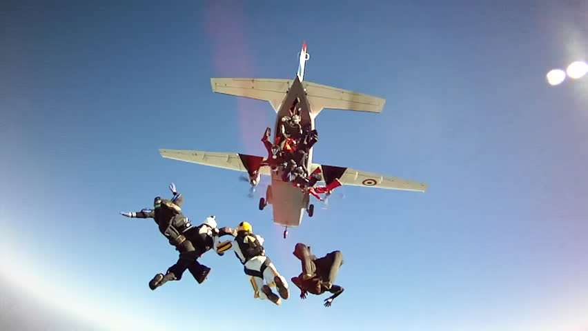 Skydiving Exit from airplane in blue sky