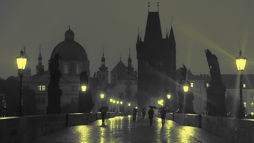 Czech Republic. Prague. Charles Bridge at night. Pedestrians with umbrellas are walking slowly in the light of street lamps. Slow motion   Shutterstock HD Video #29046121