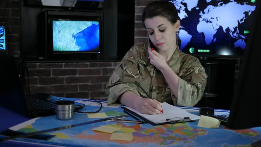 Portrait woman soldier with mobile phone, military staff, attack and security, control center, war base, working process, | Shutterstock HD Video #29056249
